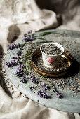 Vintage teacup full of dried lavender