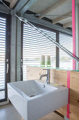 Modern houseboat: simple bathroom with sink and mirror