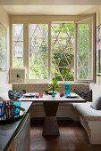 Corner bench below window in kitchen of period apartment