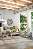 Rattan furniture on veranda with concrete floor