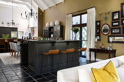 Counter and bar stools as partition between kitchen and lounge