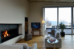 Seating area with fireplace and floor-to-ceiling sliding glass doors leading onto roof terrace