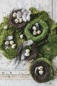 Wreaths of moss and Easter nests with quail's eggs