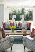 Armchairs, coffee table and cushions on bench