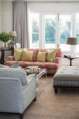 Scatter cushions on sofa in bright living room