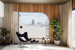 Classic chair with ottoman in front of window