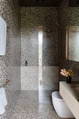 Shower area in the bathroom with mosaic tiles