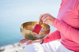 Woman holding a singing bowl