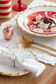 Festive place settings with gnome and gold cutlery