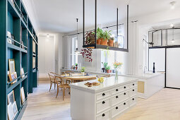 Kitchen and dining room in open-plan interior in converted tenement
