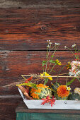 Ornamental squash used as vases for autumnal flowers