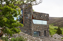 Modern architect-designed house integrated into landscape