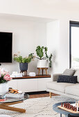 Plant stand on the sideboard in the modern living room
