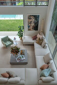 View from gallery of spacious sofa landscape in architect's house