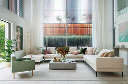 Spacious sofa landscape in an architect's house with double room height