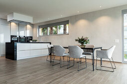 Minimalist kitchen-dining room in grey and beige