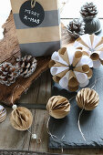 Handcrafted Christmas decorations: small, paper honeycomb balls and rosettes for hanging up