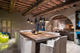 Wood-beamed ceiling in modern dining room of rustic country house