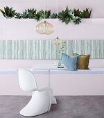 Built-in bench, house plants above, side table and classic chair