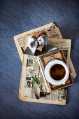 Old newspaper, gift, book, cup of coffee and flower