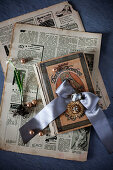 Old newspaper, book, jewellery and flower