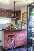 Island counter on castors with rustic board front