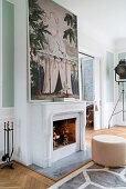 Pouffe in front of fireplace below large art print