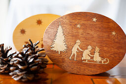 Wooden boxes with inlaid lids and Christmas decorations