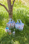 Hand-sewn picnic bags and cool bags on lawn
