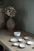 White clay shells on wooden table