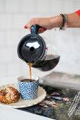 Coffee being poured into coffee mug