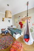 Hanging chair and wall stickers in child's bedroom