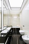 Elegant bathroom with black marble elements