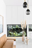 Built-in terrarium for plants as wall decoration in a modern living room