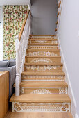 Staircase with white lacy patterns painted on risers