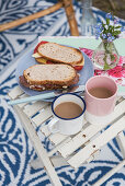 Sandwiches and coffee cups on folding table outside