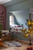 Pale blue cubby bed in festively decorated child's bedroom