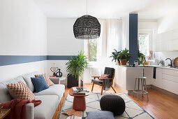 Japandi-style multifunctional interior in blue and white