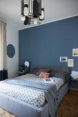 Blue wall in Japandi-style bedroom