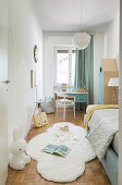 Small child's bedroom in pale blue and white