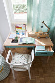 Desk below window in child's bedroom in blue and white