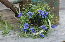Cornflower with ears of rye wreath with grasses