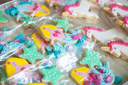 Ornately decorated mermaid and unicorn biscuits