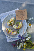 White bread with edible flowers and posy of wildflowers