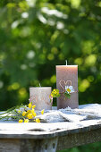 Pillar candles decorated with copper wire and wild summer flowers