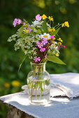 Vase of summer wildflowers with red campion, buttercups, ground elder and ox-eye daisies