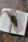 Handmade bookmarks with painted leaf motif