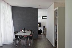 Modern, open-plan interior in shades of grey