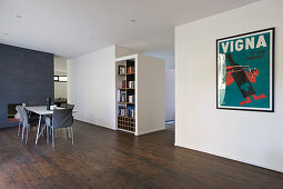 Minimalist interior with dining set on dark floor