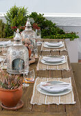 A table laid for a meal on raised decking